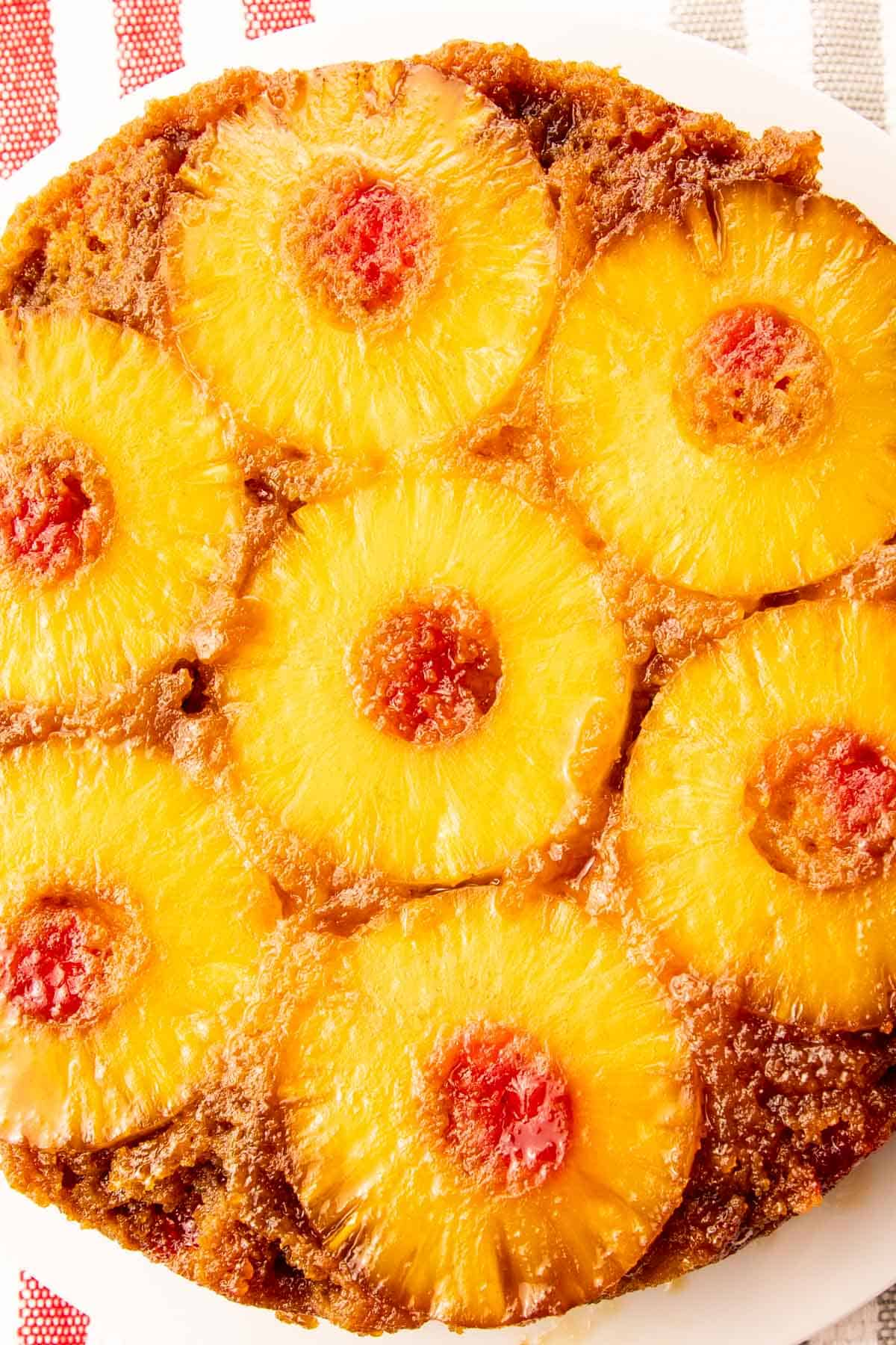 Classic pineapple upside-down cake with maraschino cherries is perfect for dessert, snacks, or with coffee. Simple but delicious. via @seasiderecipes