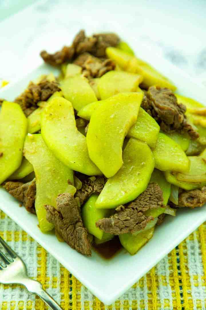 Sauteed Beef and Chayote Squash in a white square plate