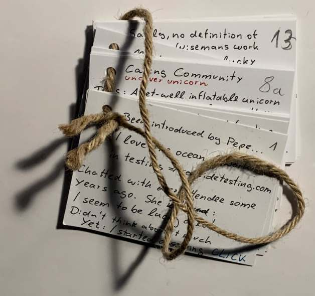 Index cards on a thread, to prevent shuffling