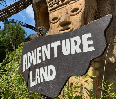 """A sign in LegoLand saying """"Adventure Land"""""""