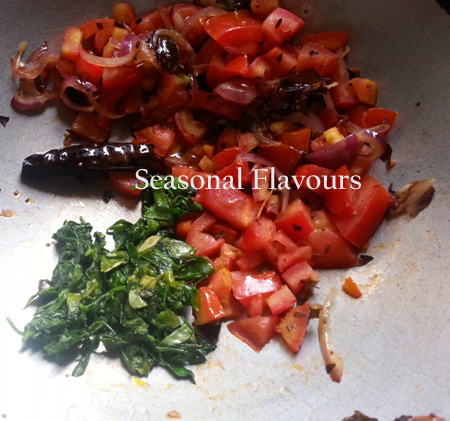 Add tomatoes and fenugreek leaves to dal seasoning for dal Andhra style recipe