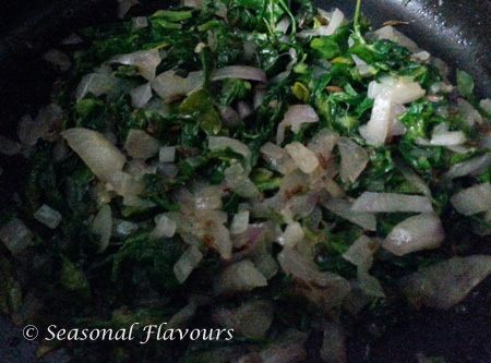 Add methi leaves to fried onions for Methi Mutter Malai