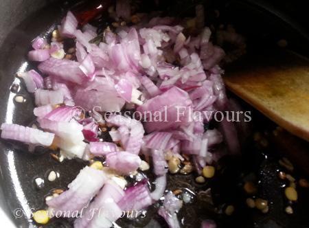 Add onions, garlic to Aratikaya Fry tempering
