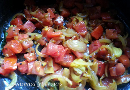 Add tomatoes for Garlic Tomato Dal