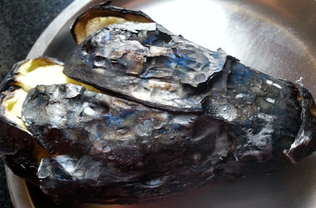 Peel the skin of smoked brinjal