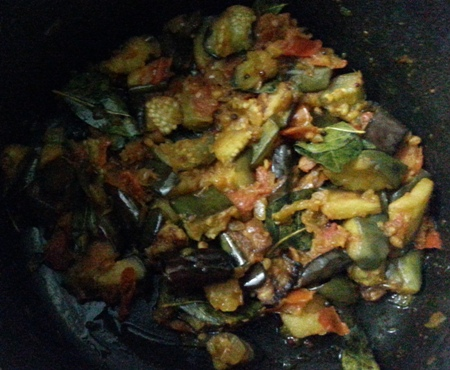 Add fried brinjal cubes to tomato curry