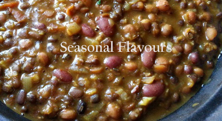 Simmer the boiled lentils and beans for Maa ki dal recipe
