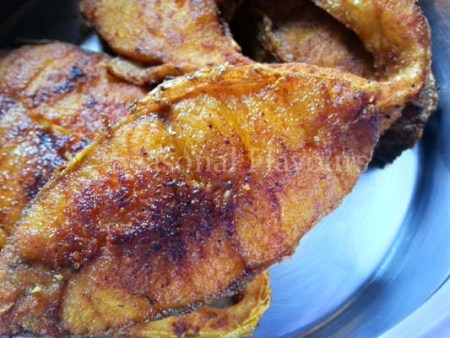 Remove fried fish from pan for Andhra chepala fry recipe