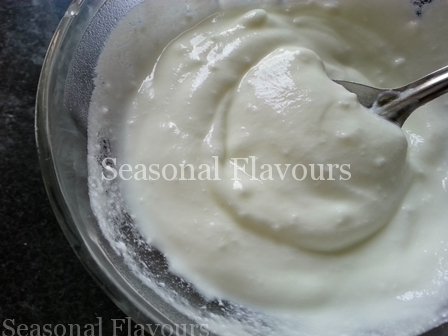 Whisk yogurt for Carrot ka raita recipe