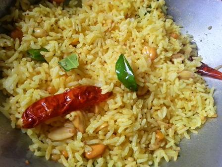 Add lemon juice to Pulihora rice for Yellow Rice Recipe