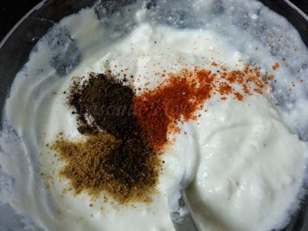 Add spices to boondi dahi raita recipe