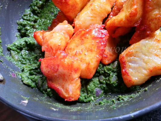 add fried fish to coriander paste for cilantro fish recipe