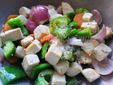 Add spices for stir fried paneer recipe Chinese style