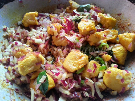 Mix chicken with onions and chillies for dry chicken fry recipe