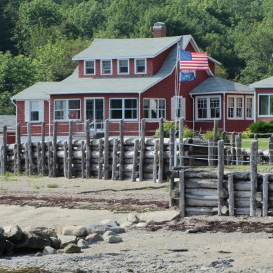 Red clapboard cottage on the beach