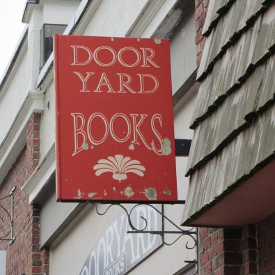 Red sign welcoming you to this book store.