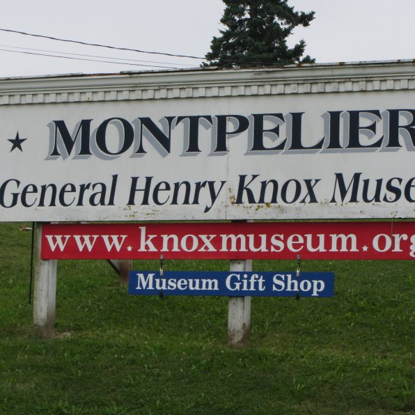 Sign on knoll letting you know about the Museum.