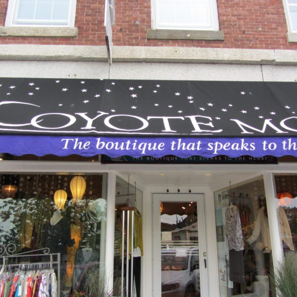 Black and purple awnig invites customers to their door.