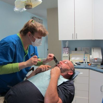 We feel very fortunate to have Dara helping us out. Dara is our hygienist and normally would not be helping us out with this project. Her specialty is cleaning teeth. But Dara worked many years for Zanca Orthodoncs, where she learned how to take intraoral photos.