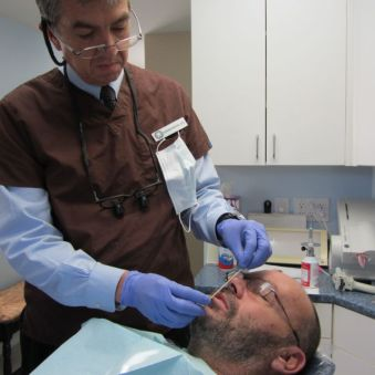 We made the upper wax rim first, working it against his lower older, existing denture.