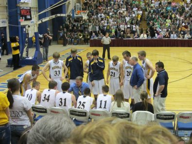 Coach DePatsy addresses the team during a time out
