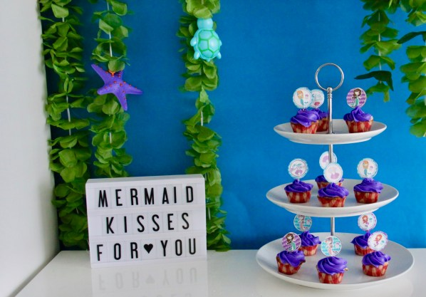 mermaid birthday party cupcakes and sign displayed