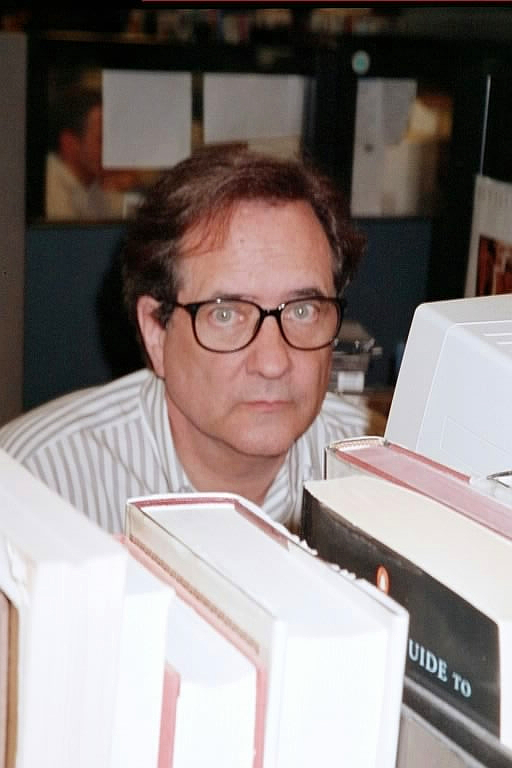 R.M. Campbell at his desk at the P-I in 2002. Photo courtesy of Jane Hadley.