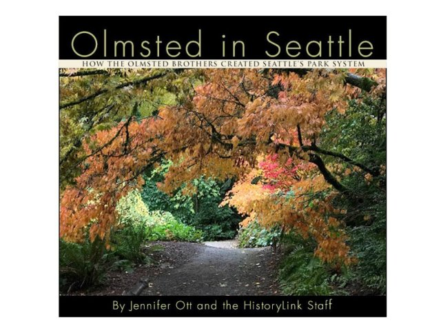 "Color photo of woodland path with arching branches full of yellowing leaves overhead. A lighter path and brighter foliage in background indicate a clearing in the woods. Image is bordered at top and bottom with black bands and light text: text at top reads ""Olmsted in Seattle; How the Olmsted Brothers Created Seattle's Park System,"" and text at bottom reads ""by Jennifer Ott and the HistoryLink Staff."""