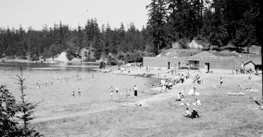 black and white photo of swimming beach