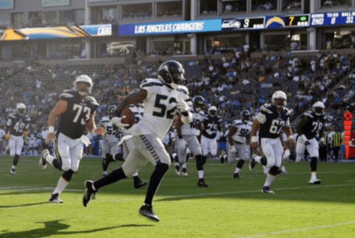 Seattle Seahawks linebacker runs back interception against LA Chargers in preseason. (AP Photo/Jae C. Hong)
