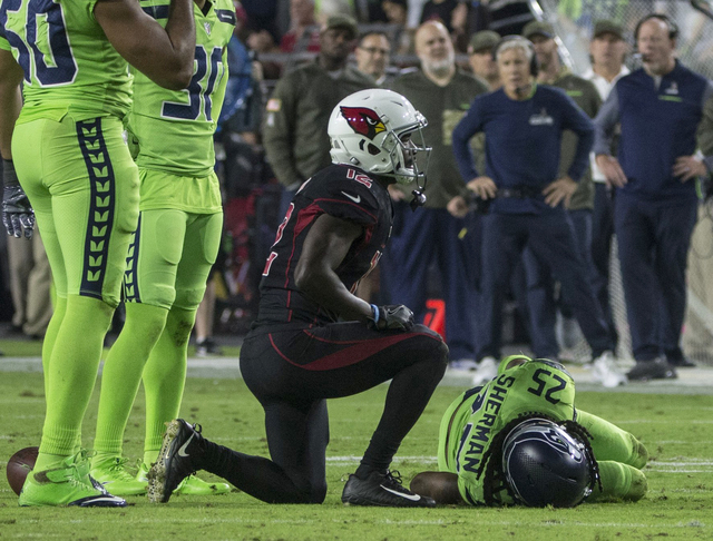 Seattle Seahawks cornerback Richard Sherman injured in the game against the Arizona Cardinals (Johanna Huckeba/The Seattle Times)