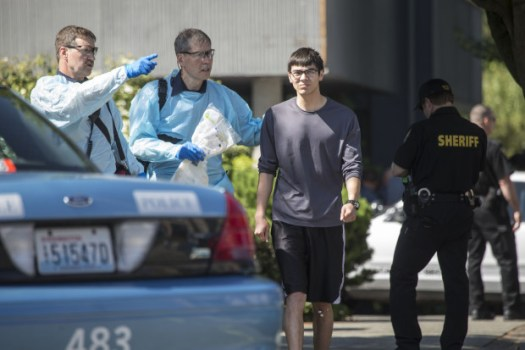 Medics attend to Jon Meis, right, after Thursday's shooting at Seattle Pacific University, when a gunman killed one student and wounded at least two others. Meis is credited with pepper-spraying the gunman and subduing him until police arrived.