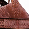 Cast Iron with lots of rivets