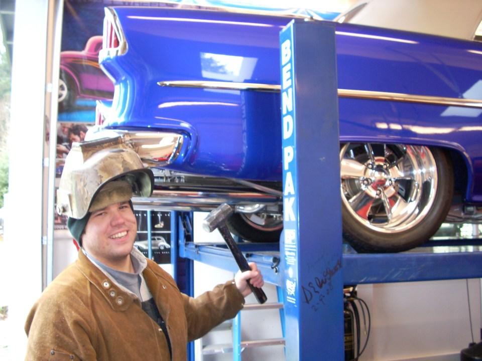 Blue custom car being fixed