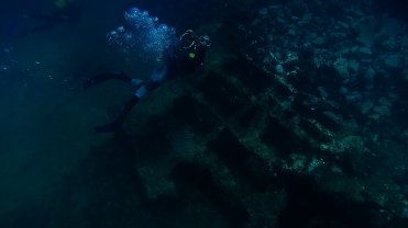 Clip 33: Renee Blundon, scuba diving alongside top of shipwreck. Dive site: Schlemmerstad Wreck