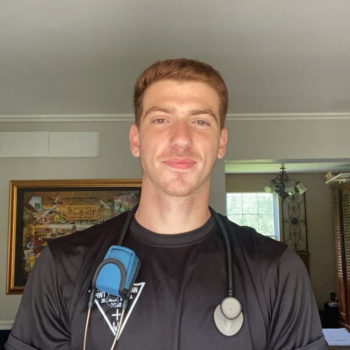 Photo of Vincenzo Stellato in EMT clothes and stethoscope draped over shoulder