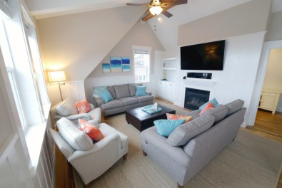 "The Living Room offers ample seating and a 60"" television"
