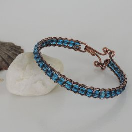 Antiqued copper bracelet with blue glass beads