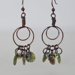 Copper hoop earrings with beads and shells
