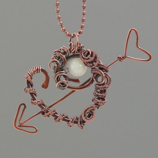 Arrow through heart copper woven pendant