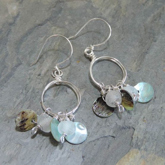 Silver hoop earrings with beads and shell disks