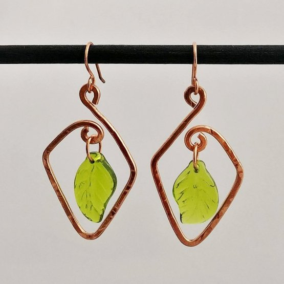image of Copper earrings with green glass leaves