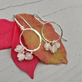 image of Argentium silver threader hoop earrings with Rainbow Moonstone beads on autumn leaves