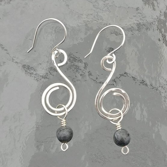 Image of silver spiral earrrings with a Larvikite bead dangle