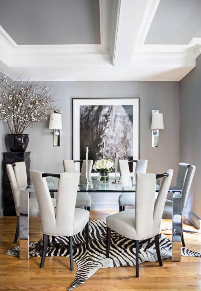 Ryan-Korban-NYC-apt-dining-room-gray-silver-chrome-zebra-rug-horse-photo-ivory-chairs