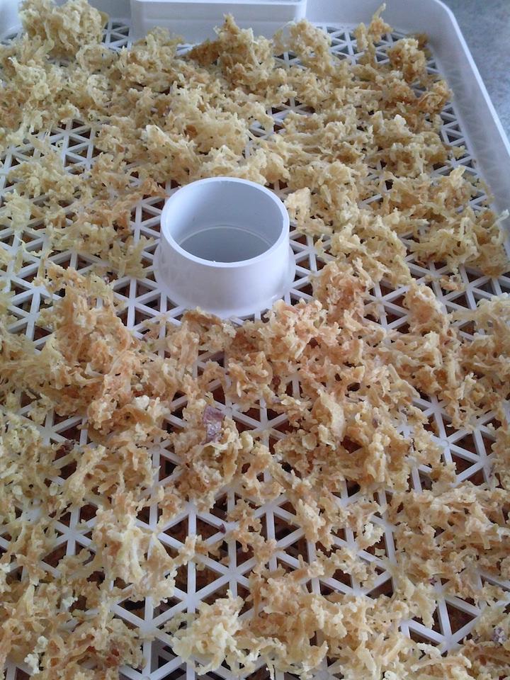 Hash browns dried on my dehydrator trays.