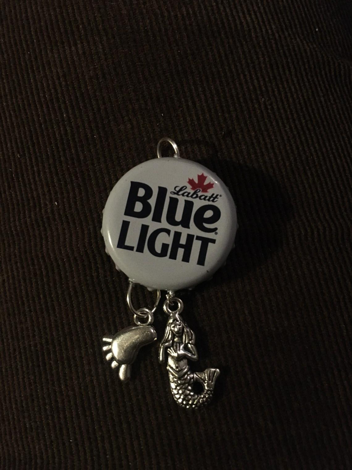 Labatt Blue Light pendant with 2 beach charms