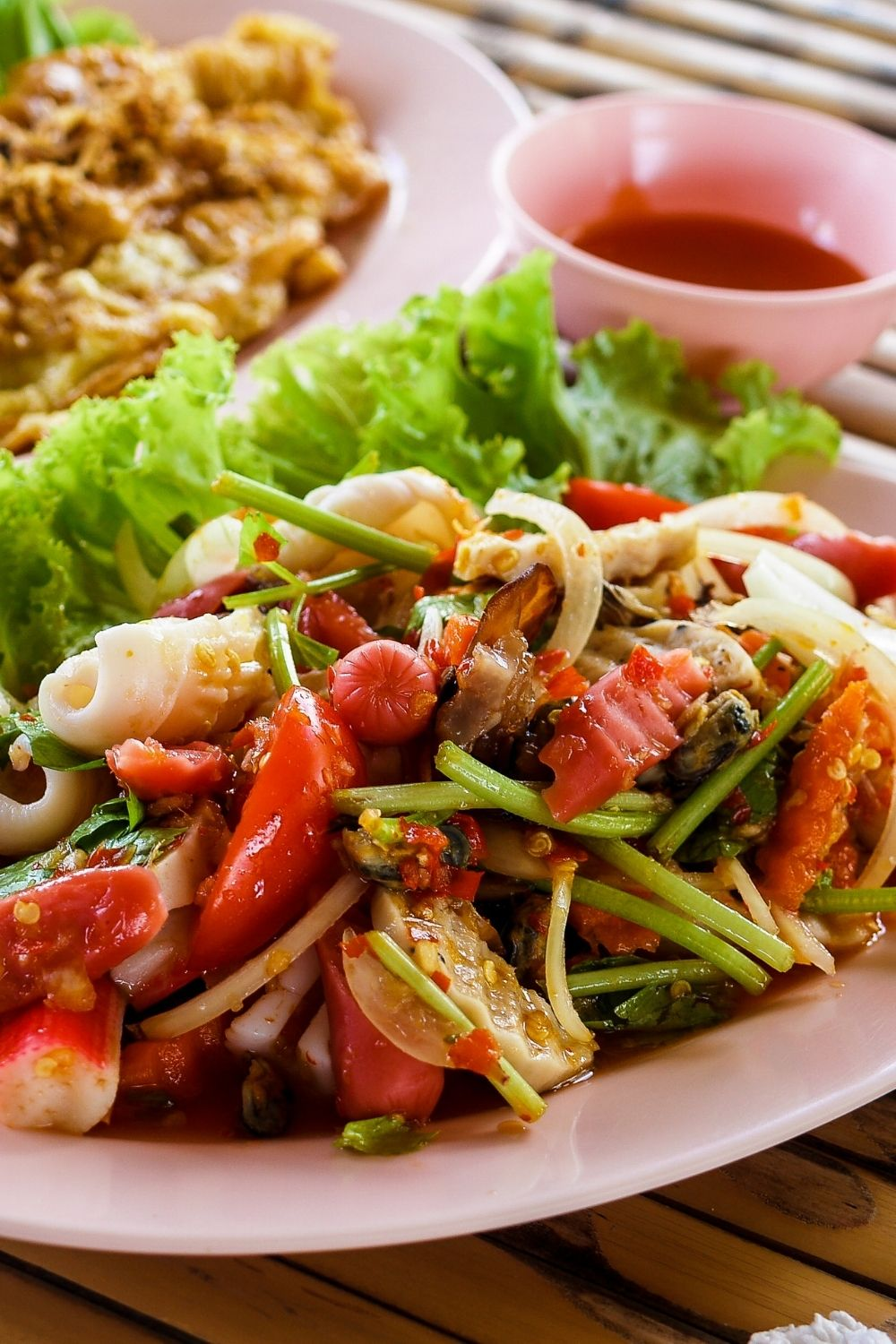 a close up view of a plate of fresh salad