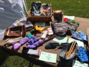 crocheted and sewn crafts at Second Time Around Homestead's booth at a farmers market.
