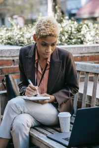 serious ethnic worker with pen and notebook